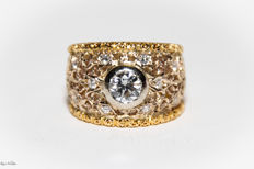 Band ring in 18 kt white and yellow gold, hand-carved floral design Central 0.50 ct diamond + 0.20 ct accent diamonds