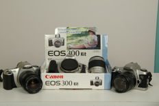 3 Canon EOS cameras with lenses