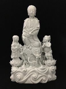 Guanyin and two boys - China - 21st century