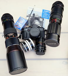 Beautiful Canon T60 with four lenses: 50mm, 35-70mm, 90-230mm and Vivitar 400mm, all in suede camera bag Camera from 1990