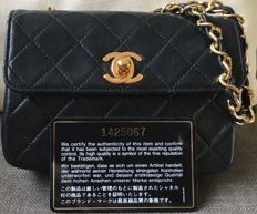 Chanel - Black Quilted Lambskin Leather Mini Flap Handtas