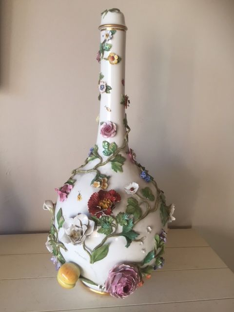 A Large Meissen Bottle Vase With Lid Decorated With Flower In Relief