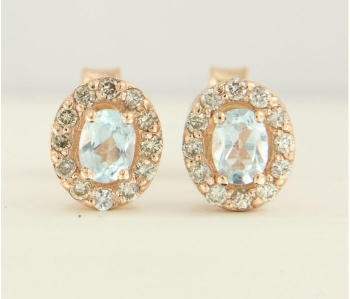14 kt red gold entourage ear studs set with blue topaz and brilliant cut diamonds, measurements 7.1 x 6.0 mm