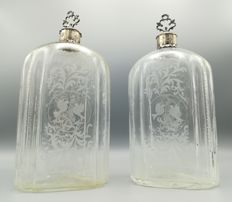 Pair of antique and finely engraved bottles with caps and collar in silver, Bohemia, 18th century