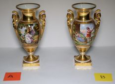 Pair of amphora-shaped vases, painted polychrome porcelain with gallant scenes and gold finishes in Raffaele Giovine style