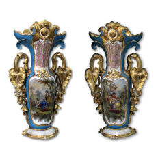 Pair of polychrome porcelain vases with gold finishes featuring popular scenes painted in Raffaele Giovine style