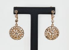 Gold earrings with antique cut diamonds.