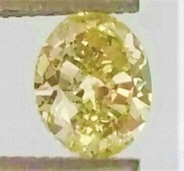 0.68 Carat -Natural Fancy Intense Yellow -  Oval Cut Diamond - SI1 clarity - IGL certified - Laser Inscripted .