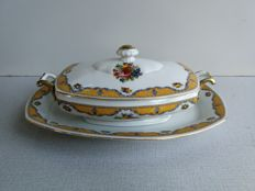 Porcelain lidded terrine bowl on under-dish with fruit depictions, golden highlights and edge decoration