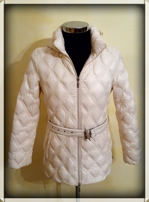 Women's quilted jacket by Moncler. CLASS 1 GENUINE eiderdown padding