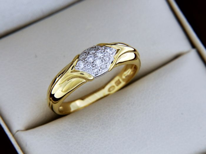 Jewellery ring in 18 kt Gold + Diamonds