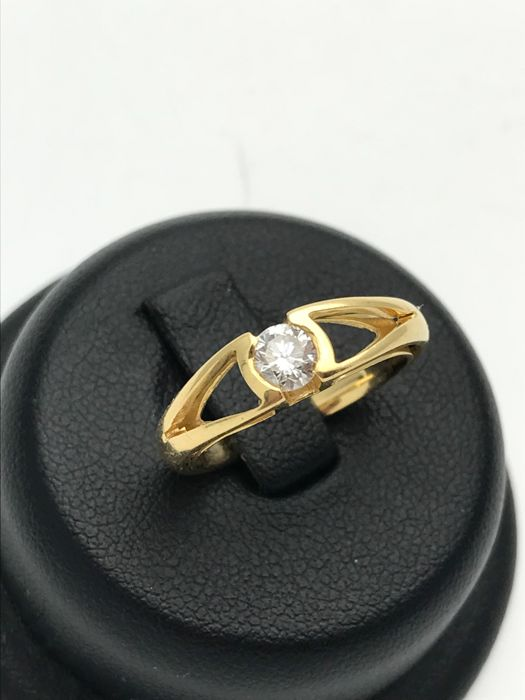 Diamond solitaire ring approx. 0.25 ct, designer setting made of 18 kt / 750 yellow gold - size 50