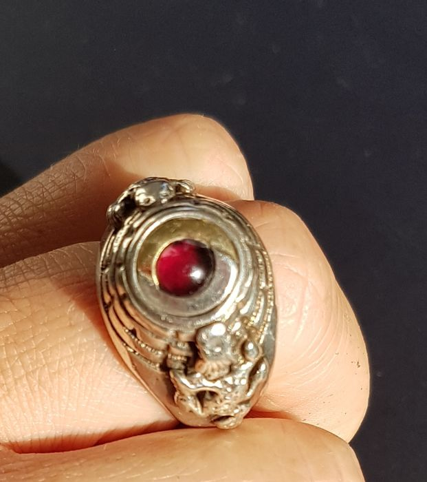 "Vintage German silver and garnet poison ring, engraved with ""Ich atme tief und ohne Angst"""