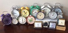 A collection of 16 vintage alarm clocks