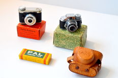 Two miniature cameras + box with rolls of film