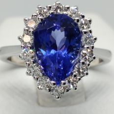 Halo 18 kt gold ring with pear cut tanzanite of 2.36 ct and 14 diamonds for approx. 0.56 ct