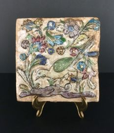 Persian tile with reliefs, poly-chrome flowers and bird decoration - Iran - 18th century