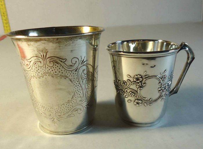 2 pieces in solid silver - a cup with the boar assay office mark from 1886 to 1938 and a mug with the Lisbon crown assay office mark from 1816 to 1828, Portugal
