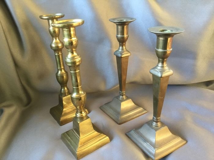 Two sets of bronze candlesticks, Belgium, 1st half 19th century
