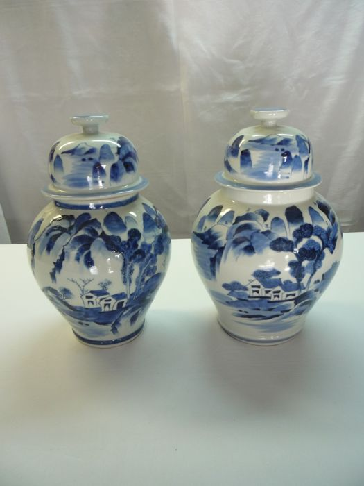 A Pair Of Bluewhite Lidded Vases With Landscape Paintings Marked