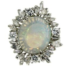 Opal & Diamond cluster Cocktail ring set with an Opal weighing 4.38 carat, 1970 Italy