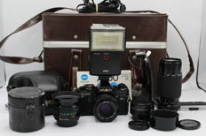 Minolta X-700 with a collection of lenses (28, 50, 70-210), teleconverter, flash and beautiful case - (2899)