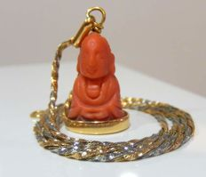 Twisted chain in 2 gold 18 kt, and red coral Buddha on gold, weight 9.50 g