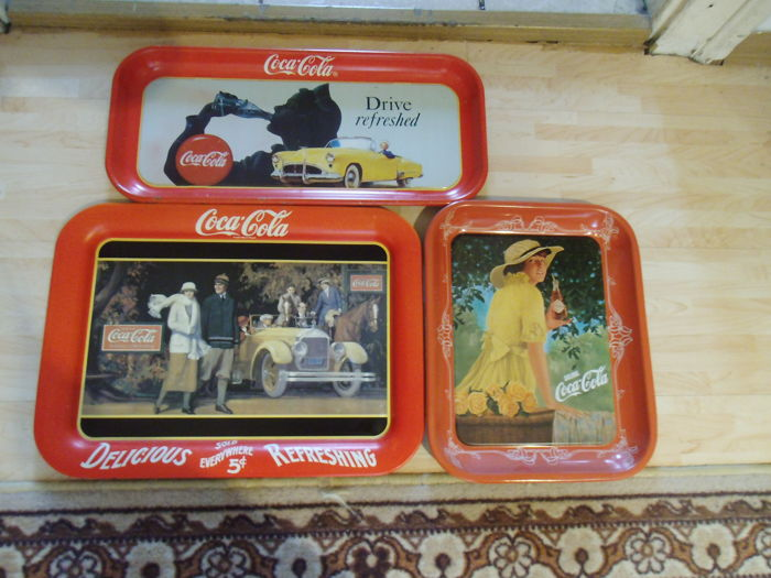 3 Coca Cola tin trays from 1987/ 1990/ 1970