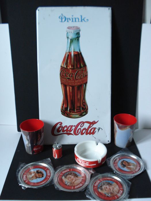Coca-Cola advertisement, old plate, 4 coasters, one ashtray, a lighter and 2 cups.