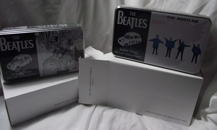 Two highly collectible Beatles die cast, 'Album cover taxis'. Help! and Revolver( 2008 ).