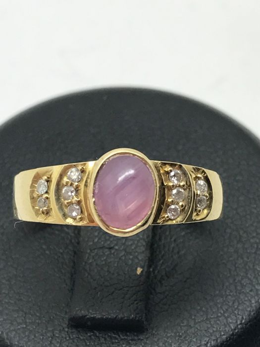 Rose quartz band ring with diamond accents in 14 kt / 585 yellow gold