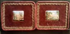 Pair of polychrome ceramic miniatures decorated with river landscapes