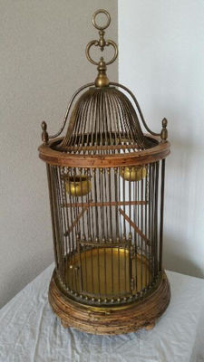 Antique bird cage of wood and brass, mid 20th century
