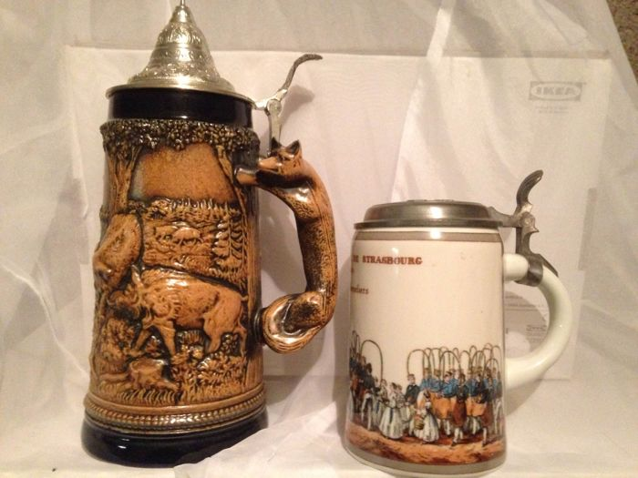 WAID manns heid 34 cm fully-vitrified stoneware tankard with pewter lid from 1938, plus Kronenbourg fully-vitrified stoneware advertising tankard with pewter lid, from the mid 20th century