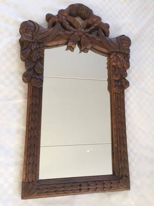 An oak mirror in the style of Louis XVI, 20th century