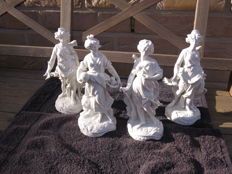 Four white porcelain female sculptures, various scenes Capodimonte mark.