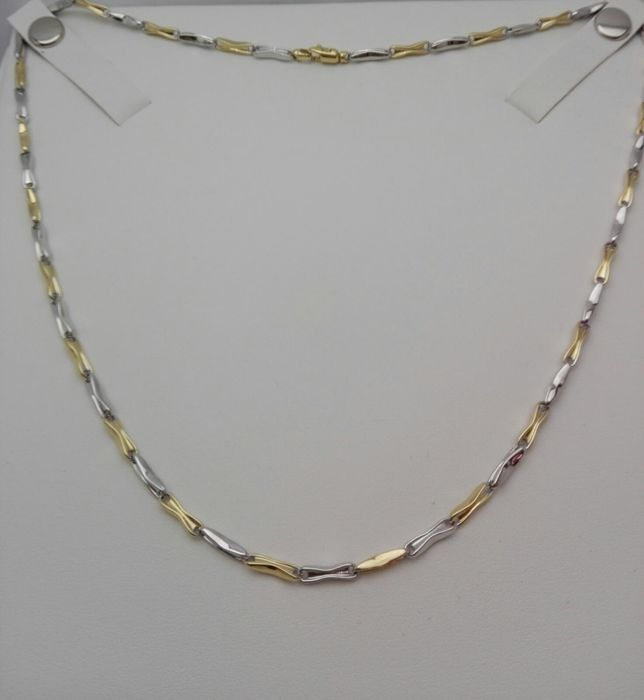 Unisex necklace in 18 kt white and yellow gold Weight: 10.2 g