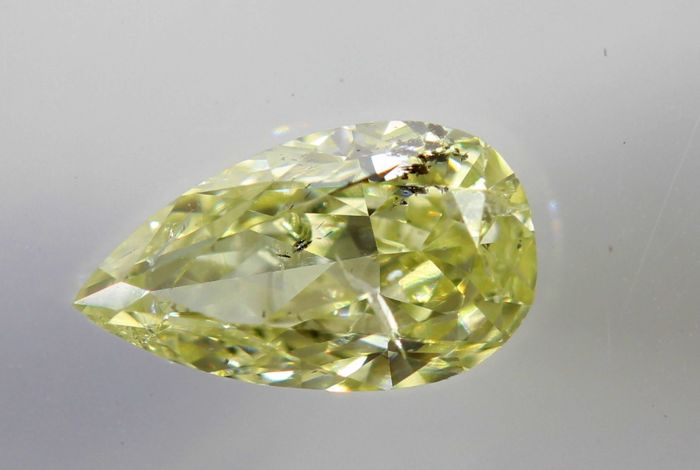 AIG Diamant - 0.49 ct - Fancy Light Yellow , SI2 - *  No Reserve Price *