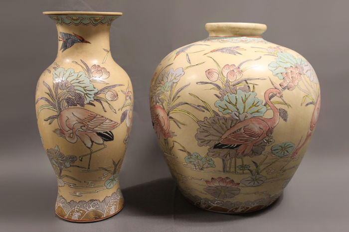 A decorated pair Chinese vases with floral and animal scenery - China - late 20th Century