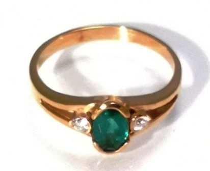 Italian design ring in 18 kt gold with deep green faceted oval emerald, clean with no inclusions