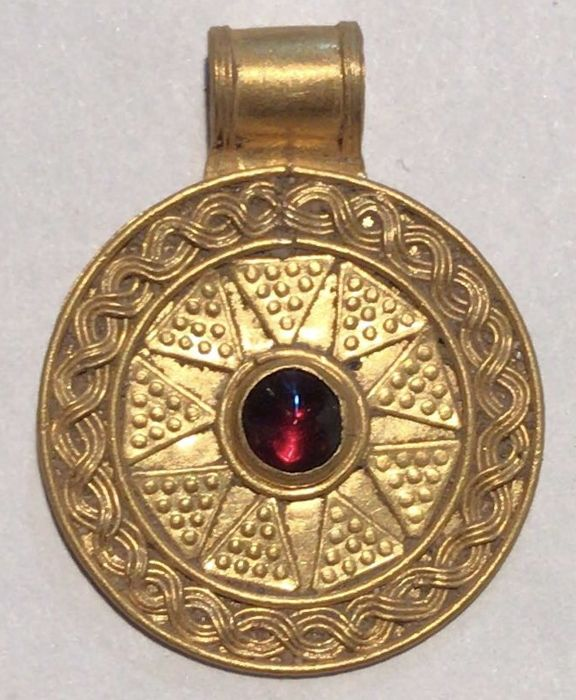 Viking Gold medallion with many ornaments and garnet ...