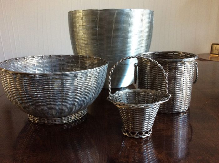 4 braided white metal baskets of which 3 silver are plated, France, 20th century