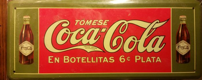 Various Coca Cola advertising signs