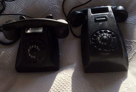 Ericsson Bakelite wall-mounted phone PTT, and a PTT Bakelite telephone, 1950-1960