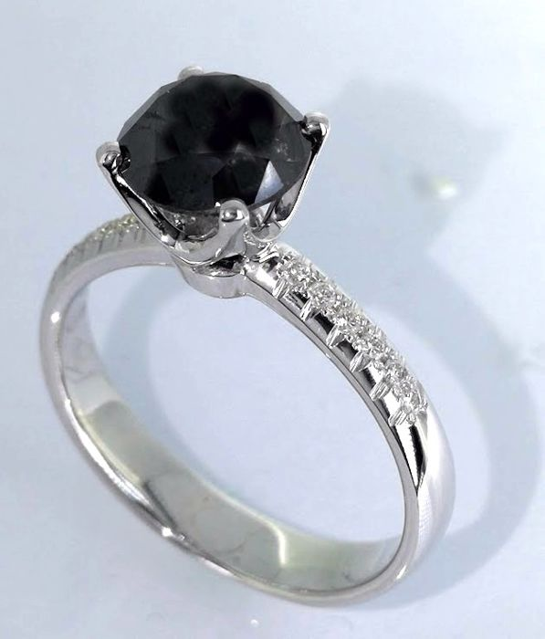 Golden  ring  with a black diamond  1.50 ct & white 12 diamonds  *** No reserve price***