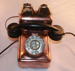 Vintage Den Bell telephone, brass and copper, MFG Antwerp with a dial, first half of the 20th century