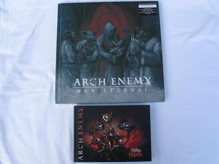 Arch Enemy ; The Luxe Artbook ( War Eternal ) + 3 CD's. And the artbook ; Khaos Legions + 2 CD's