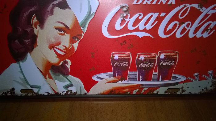 Vintage advertising for the famous American soft drinks company Coca Cola.