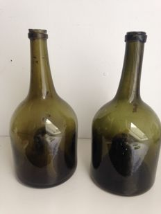 Two hand-blown dark green glass wine bottles, with high pontil Southern Netherlands, late 18th century