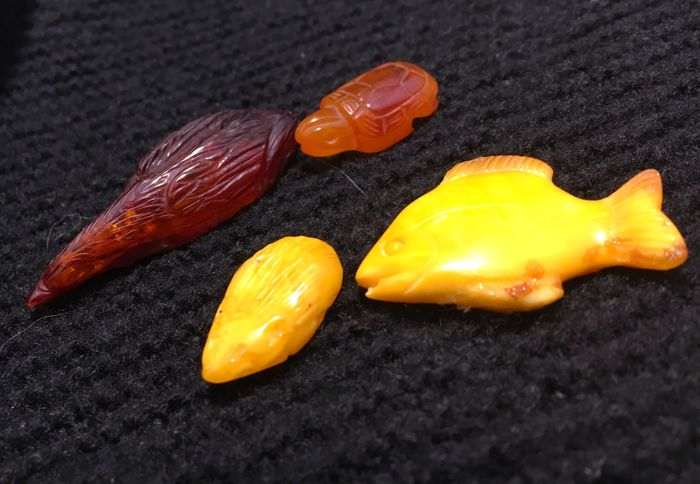 collection of animal figures hand carved from natural amber stone